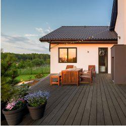 Cozy villa patio with decorative plants and wooden flooring